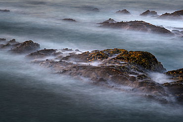 A view from Bluff trail of waves washing over rock fins at Montaña de Oro State Park, on the central California coast.