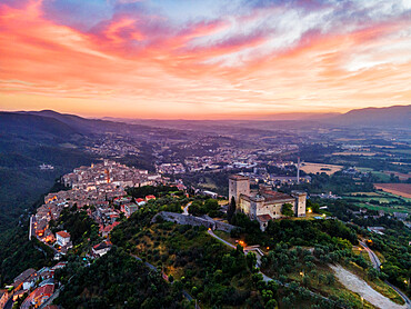 Cityscape of Narni at sunrise, with the fortress at the front and the old town beyond, Narni, Umbria, Italy, Europe