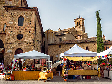 The street market of Bevagna's old town in the square behind Piazza Silvestri, with St. Silvestro's Church in the background