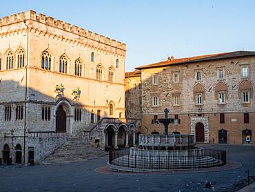Piazza IV November in Perugia with Fontana Maggiore and Palazzo dei Consoli at sunrise