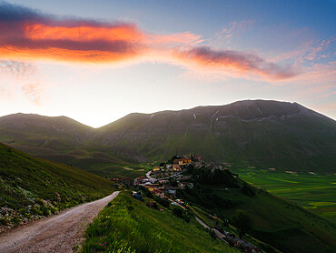 View of the village of Castelluccio di Norcia, PG, Umbria, Italy, Europe with the lentil fields and the mountains, at sunrise