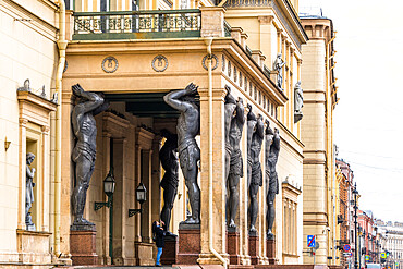Atlantes, granite giants by sculptor Alexander Terebenev supporting the portico of the New Hermitage, St. Petersburg, Russia, Europe