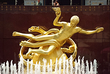 Gold sculpture above a water fountain, Rockefeller Center, Manhattan, New York City, United States of America, North America