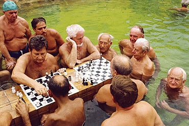 Bathers playing chess in the water at the Szechenyi Baths in Budapest, Hungary, Europe