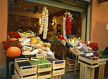 Vegetable shop selling garlic, olives and squash, in the market in Bologna, Emilia Romagna, Italy, Europe
