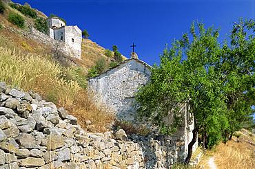 Old Byzantine churches on a hillside, Aegina, Saronic Islands, Greek Islands, Greece, Europe