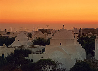 White domes of the Chora at sunset on Folegandros, Cyclades, Greek Islands, Greece, Europe