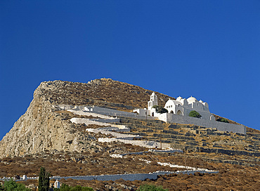 White walls line zigzag path up to Church of the Assumption of the Virgin Mary, above terraces on Folegandros, Cyclades, Greek Islands, Greece, Europe