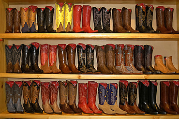 Display of ornate cowboy boots in a shop in Aspen, Colorado, USA, North America