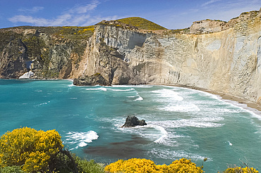 Chalk cliffs surrounding a small emerald coloured bay on the island of Ponza, off the southwest coast of Italy, Italy, Mediterrranean, Europe