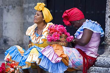 Flower girls in Plaza de la Catedral, Habana Vieja, Havana, Cuba, West Indies, Central America