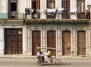 People riding in a rickshaw, central Havana, Cuba, West Indies, Central America