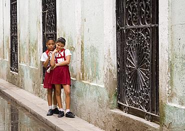 Two schoolgirls on a street in Habana Vieja, Havana, Cuba, West Indies, Central America