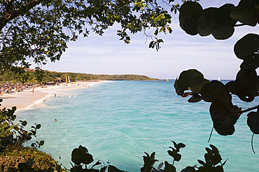 A view through trees to the Playa Esmeralda, Carretera Guardalavaca, Cuba, West Indies, Central America