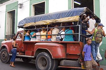 Old truck transporting passengers, Havana, Cuba, West Indies, Central America