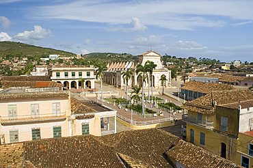 An elevated view of the terracotta roofs and the Iglesia Parroquial de la Santisma Trinidad, Trinidad, UNESCO World Heritage Site, Cuba, West Indies, Central America