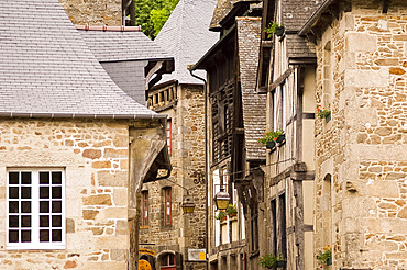Old half timbered and stone buildings in the picturesque village of Dinan, Brittany, France, Europe