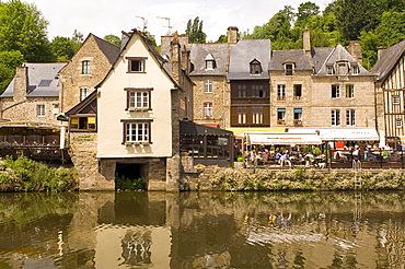 Waterfront cafes next to medieval timber and stone buildings in Port du Dinan on the River Rance, Dinan, Brittany, France, Europe