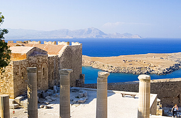 Columns and the sea from The Acropolis, Lindos, Rhodes, Dodecanese Islands, Greek Islands, Greece, Europe