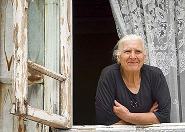 An old lady looking out her window, Batumi, Georgia, Eurasia