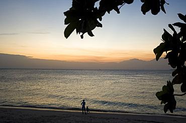 People walking on the beach at sunset, Stone Town, Zanzibar, Tanzania, East Africa, Africa