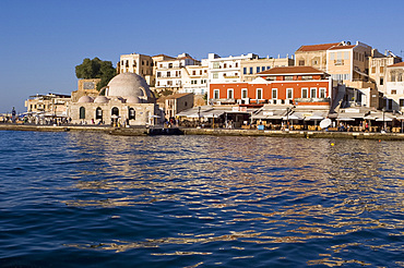 A view of tavernas around the harbour and the Kutchuk Hasan Mosque in the old town section of Hania (Chania) (Xania), Crete, Greece, Europe