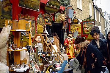 Assorted antiques displayed outside shop, Portobello Market, London, England, United Kingdom, Europe