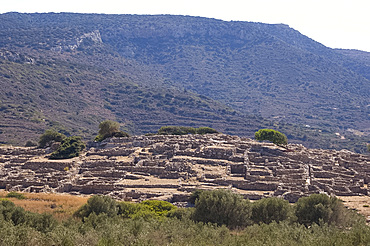 Low stone walls at the ancient Minoan town of Gournia above the Gulf of Mirambellou, Crete, Greek Islands, Greece, Europe