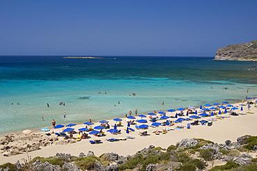 Umbrellas on the beach and emerald seas at Phalassarna (Falassarna) in Western Crete, Greek Islands, Greece, Europe