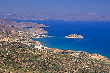 A view of the coastline from Mirsini toward Mohlos on the road to Sitia on the north coast of Crete, Greek Islands, Greece, Europe