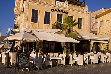 A taverna on the harbour in the old section of Hania, Crete, Greek Islands, Greece, Europe