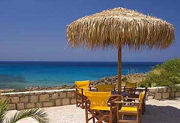 A table overlooking the beach and emerald seas at Phalassarna (Falassarna) in Western Crete, Greek Islands, Greece, Europe