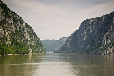 The Danube River flowing through the Kazan Gorge in the Iron Gates Region between Serbia and Romania, Europe