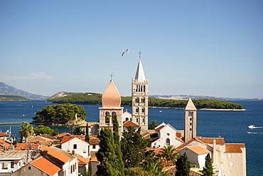 Medieval bell towers and terracotta roofs in Rab Town, island of Rab, Kvarner region, Croatia, Europe