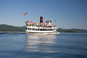 The Mohican, a sightseeing excursion boat heading toward Dome Island on Lake George, Adirondack Mountains, New York State, United States of America, North America