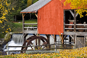 Autumn foliage around the old mill and waterfall in Weston, Vermont, New England, United States of America, North America