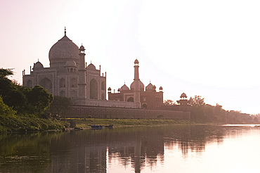 The Taj Mahal, UNESCO World Heritage Site, at sunset reflected in the Yamuna River, Agra, Uttar Pradesh, India, Asia
