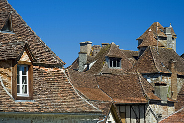 Rooftops in the picturesque village of Carennac and its typical Quercy architecture situated on the banks of the Dordogne River, Dordogne, France, Europe