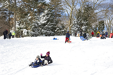 Children sledding in Central Park after a blizzard in New York City, New York State, United States of America, North America
