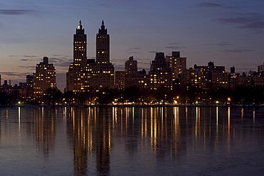 Skyline reflections on the ice on the reservoir in Central Park, New York City, New York State, United States of America, North America