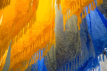 Brightly coloured dyed fabrics hanging to dry in the dyers souk, Marrakech, Morocco, North Africa, Africa