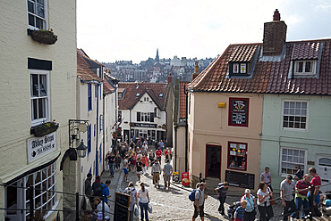 Tourists on the streets of Whitby on a summer day, Yorkshire, England, United Kingdom, Europe