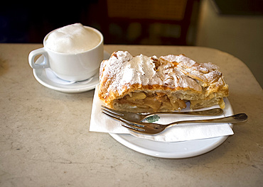 Apple strudel and cappuccino served in the Tomaselli Cafe in the Altstadt, Salzburg, Austira, Europe
