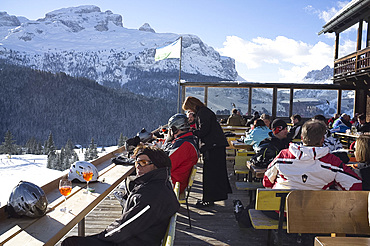 Colourful afternoon drinks at a mountain restaurant at the Alta Badia ski area, Corvara, The Dolomites, South Tyrol, Italy, Europe