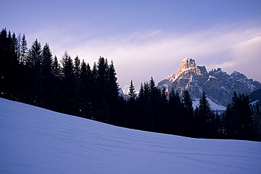 The last run, a view of Sassongher mountain at sunset from a piste at Alta Badia ski resort, Dolomites, South Tyrol, Italy, Europe