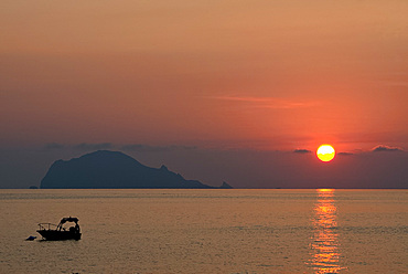 A view to Filicudi Island from Salina Island at sunrise in The Aeolian Islands, UNESCO World Heritage Site, off Sicily, Messina Province, Italy, Mediterranean, Europe