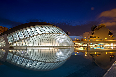 The Hemisferic building and Palace of Arts Reina Sofia in the Arts and Science Center at dusk mirrored in a reflecting pool, Valencia, Spain, Europe