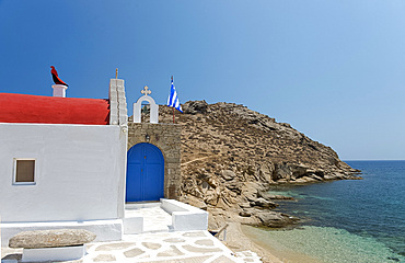A red domed seafront church on Mykonos, The Cyclades, Geek Islands, Greece, Europe