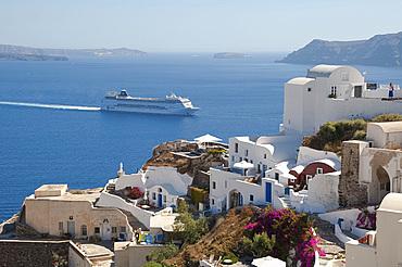 A large cruise ship off the island of Santorini, The Cyclades, Greek Islands, Greece, Europe