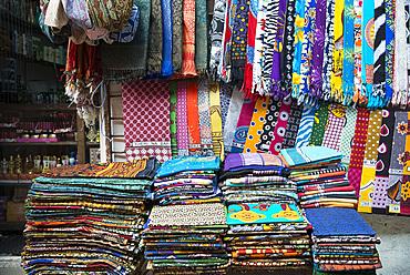Colourful African fabrics on display in the market in Stone Town, Zanzibar, Tanzania, East Africa, Africa